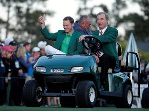 Masters champion Danny Willett, of England, gives a thumbs up while being driven in a golf cart following his win of the Masters golf tournament Sunday, April 10, 2016, in Augusta, Ga. (AP Photo/Charlie Riedel)