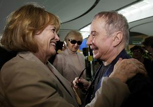File picture of Paul Simon being greeted by the widow of the late poet Seamus Heaney in an event at Dublin Airport (Brian Lawless/PA)