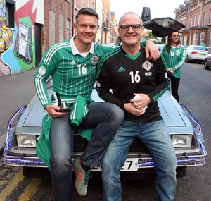 PACEMAKER BELFAST   08/10/2015 Excited Northern Ireland fans before this evenings crucial game against Greece at Windsor Park. Johnathan Irvine and Oliver Norwoods dad (right) before the match. Picture Matt Bohill.