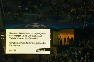 The information board announces that the match has being postponed and will be blayed the following day at 18:45 after the team bus of Borussia Dortmund had some windows broken by an explosion some 10km away from the stadium prior to the UEFA Champions League 1st leg quarter-final football match BVB Borussia Dortmund v Monaco in Dortmund, western Germany on April 11, 2017.  / AFP PHOTO / Odd ANDERSENODD ANDERSEN/AFP/Getty Images