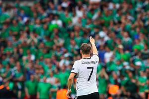 PARIS, FRANCE - JUNE 21:   Bastian Schweinsteiger of Germany celebrates his team's 1-0 win in the UEFA EURO 2016 Group C match between Northern Ireland and Germany at Parc des Princes on June 21, 2016 in Paris, France.  (Photo by Alexander Hassenstein/Getty Images)