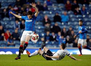 Rangers' Calum Gallagher and Ayr United's Gordon Pope battle for the ball  during the Scottish League One match at Ibrox, Glasgow.
