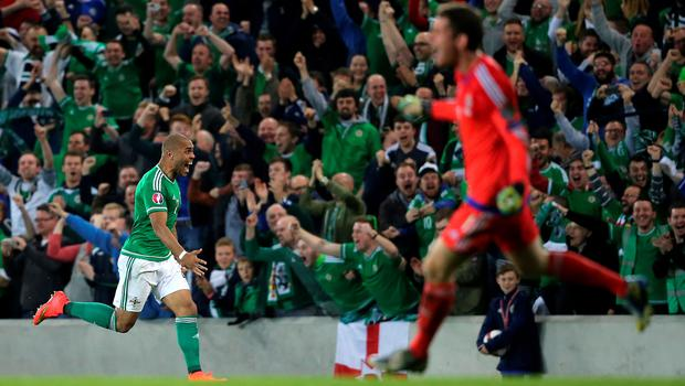Northern Ireland's Josh Magennis celebrates scoring his side's second goal of the match during the UEFA European Championship Qualifying match at Windsor Park, Belfast. PRESS ASSOCIATION Photo. Picture date: Thursday October 8, 2015. See PA story SOCCER N Ireland. Photo credit should read: Niall Carson/PA Wire.