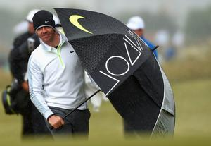 NEWCASTLE, NORTHERN IRELAND - MAY 27:  Rory McIlroy of Northern Ireland walks up the 18th hole with an umbrella during the Pro-Am round prior to the Irish Open at Royal County Down Golf Club on May 27, 2015 in Newcastle, Northern Ireland.  (Photo by Ross Kinnaird/Getty Images)