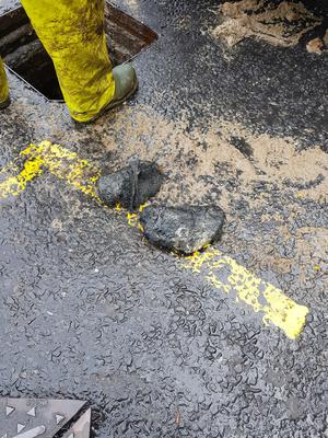 Stones pulled from a sewer in west Belfast