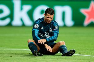 WOLFSBURG, GERMANY - APRIL 06: Cristiano Ronaldo of Real Madrid reacts during the UEFA Champions League Quarter Final First Leg match between VfL Wolfsburg and Real Madrid at Volkswagen Arena on April 6, 2016 in Wolfsburg, Germany.  (Photo by Oliver Hardt/Bongarts/Getty Images)