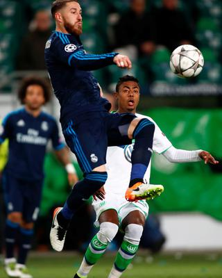 Real Madrid's defender Sergio Ramos (L) and Wolfsburg's Brazilian midfielder Luiz Gustavo vie for the ball during the UEFA Champions League quarter-final, first-leg football match between VfL Wolfsburg and Real Madrid on April 6, 2016 in Wolfsburg, northern Germany.  / AFP PHOTO / ODD ANDERSENODD ANDERSEN/AFP/Getty Images