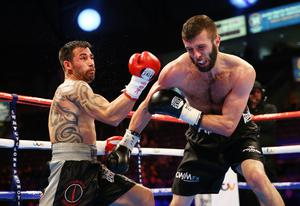 28th February 2015   ??William Cherry/Presseye  Anthony Cacace with Spain??s Santiago Bustos during Saturday nights international super featherweight contest at the Odyssey arena, Belfast