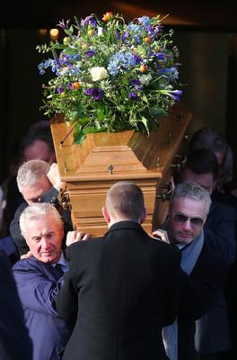 Press Eye - Belfast - Northern Ireland - 14th January 2018  Funeral for former Belfast Lord Mayor Dr Ian Adamson at Conlig Presbyterian Church in Co. Down.  The 74-year-old who died last week was a Ulster Unionist Party politician, medical doctor and historian, Dr Adamson served as Lord Mayor of Belfast in 1996/7, high sheriff in 2011 and was an Assembly member for the constituency of East Belfast from 1998 to 2003.  F1 racing star Eddie Irvine(right) helps carry the coffin from the church after the service.   Picture by Jonathan Porter/PressEye