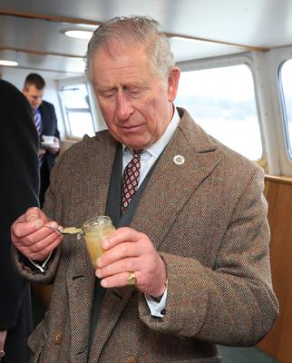 The Prince of Wales tries some marmalade aboard the Lady of the Lake, flagship vessel of the Ullswater Steamers company (Peter Bryrne/PA)