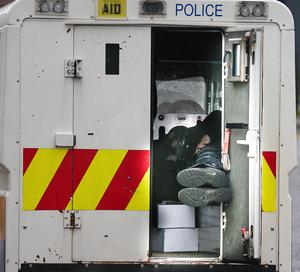 Picture - Kevin Scott / Presseye  Belfast - Northern Ireland - Monday 13th July 2015 -  Ardoyne Parade Outward   Pictured is a police office asleep in the back of a jeep at the Orange order parade and its associated protests as it makes its way past the flashpoint of the Ardoyne Shopfront in Belfast, Northern Ireland.    Picture by Kevin Scott  / Presseye.