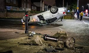 Police deal with a suspected stolen car that crashed on the Andersonstown Road in west Belfast on March 7th 2020 (Photo by Kevin Scott for Belfast Telegraph)