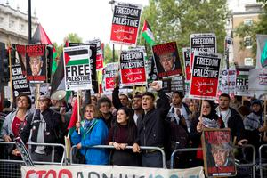 Pro-Palestinian demonstrators shout slogans as they gather to a protest outside the gates of Downing Street in London on September 9, 2015 opposing a planned visit of Israeli Prime Minister Benjamin Netanyahu. Over 100 pro-Israeli demonstrators and hundreds of pro-Palestinian activists rallied in front of Downing Street in London ahead of a planned visit of Israeli Prime Minister Benjamin Netanyahu. Netanyahu visits Britain this week for talks with his counterpart David Cameron as the right-wing Israeli leader faces diplomatic pressure over West Bank settlements and stalled peace efforts. AFP PHOTO / JUSTIN TALLISJUSTIN TALLIS/AFP/Getty Images