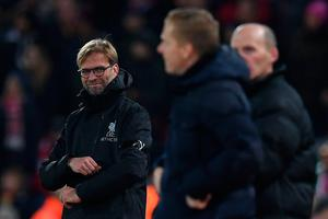 Liverpool's German manager Jurgen Klopp (L) and Leeds United's English head coach Garry Monk (C) watches his players from the touchline during the English League Cup quarter-final football match between Liverpool and Leeds United at Anfield in Liverpool, north west England on November 29, 2016. / AFP PHOTO / Paul ELLIS / RESTRICTED TO EDITORIAL USE. No use with unauthorized audio, video, data, fixture lists, club/league logos or 'live' services. Online in-match use limited to 75 images, no video emulation. No use in betting, games or single club/league/player publications.  / PAUL ELLIS/AFP/Getty Images