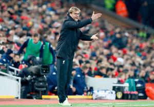 """Liverpool manager Jurgen Klopp gestures on the touchline during the EFL Cup, Quarter Final match at Anfield, Liverpool. PRESS ASSOCIATION Photo. Picture date: Tuesday November 29, 2016. See PA story SOCCER Liverpool. Photo credit should read: Martin Rickett/PA Wire. RESTRICTIONS: EDITORIAL USE ONLY No use with unauthorised audio, video, data, fixture lists, club/league logos or """"live"""" services. Online in-match use limited to 75 images, no video emulation. No use in betting, games or single club/league/player publications."""