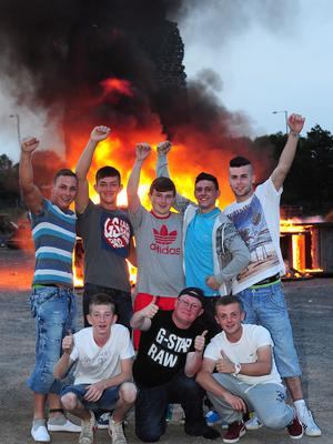 PACEMAKER BELFAST   11/07/2013 Young men pictured enjoying the Bonfire in King George Playing Fields Upper Newtownards Road Belfast. Picture By: Arthur Allison/Pacemaker Press