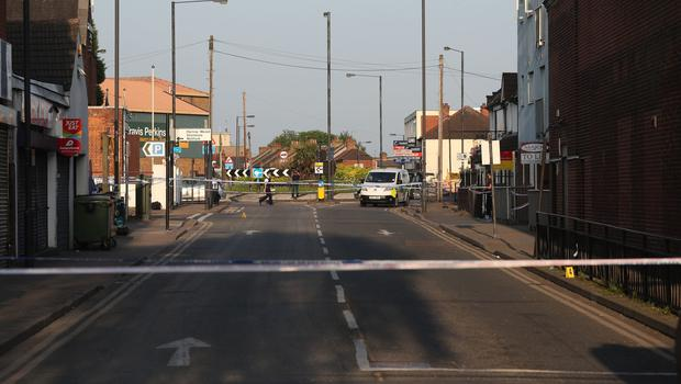 Police at Palmerston Road in Wealdstone after two boys were shot at two locations in close proximity (Jonathan Brady/PA)