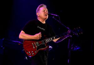 INDIO, CA - APRIL 13:  Musician Bernard Sumner of New Order performs onstage during day 2 of the 2013 Coachella Valley Music & Arts Festival at the Empire Polo Club on April 13, 2013 in Indio, California.  (Photo by Jason Kempin/Getty Images for Coachella)