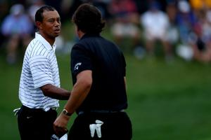 LOUISVILLE, KY - AUGUST 08:  (L-R) Tiger Woods of the United States and Phil Mickelson of the United States shake hands on the 18th green during the second round of the 96th PGA Championship at Valhalla Golf Club on August 8, 2014 in Louisville, Kentucky.  (Photo by Jeff Gross/Getty Images)