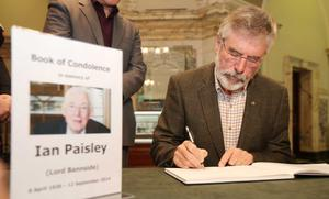 Northern Ireland- 15th September 2014 Picture by Jonathan Porter/Presseye.com  Book of condolence opened at Belfast City Hall following the death of former First Minister and DUP leader Ian Paisley who died on Friday aged 88-years-old.  Sinn Fein President Gerry Adams sings the book.