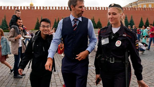 Garreth Southgate, alias lookalike Neil Rowe, causes a stir as football fans, TV crews and tourists, mistake him for the real England manager as Neil tours Red Square ahead of the World Cup semi-final.  (Photo by Christopher Furlong/Getty Images)