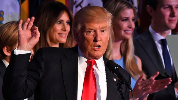 TOPSHOT - Republican presidential candidate Donald Trump flanked by members of his family speaks to supporters during election night at the New York Hilton Midtown in New York on November 9, 2016.  Trump won the US presidency. / AFP PHOTO / Timothy A. CLARYTIMOTHY A. CLARY/AFP/Getty Images