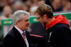 STOKE ON TRENT, ENGLAND - JANUARY 05:  Jurgen Klopp (R), Manager of Liverpool is greeted by Mark Hughes the Manager of Stoke City during the Capital One Cup semi final, first leg match between Stoke City and Liverpool at the Britannia Stadium on January 5, 2016 in Stoke on Trent, England.  (Photo by Gareth Copley/Getty Images)