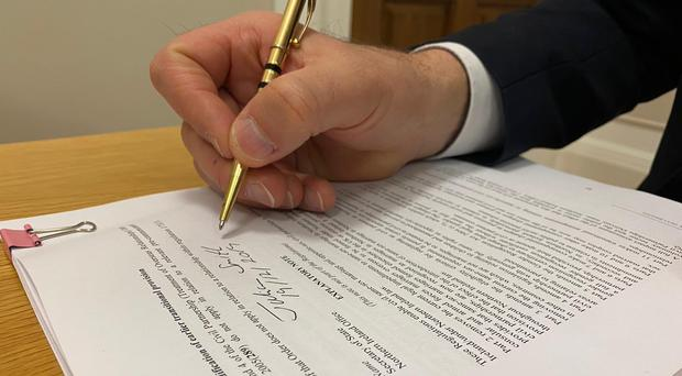 Secretary of State Julian Smith signs the regulation.