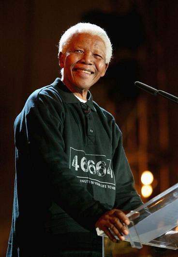 """(FILE PHOTO) Former South African President Nelson Mandela Has Died Aged 95 CAPE TOWN, SOUTH AFRICA - NOVEMBER 29:  Nelson Mandela makes a speech at the """"46664 - Give One Minute of Your Life to AIDS"""" concert at Greenpoint Stadium on November 29, 2003 in Cape Town, South Africa. The concert will benefit the Nelson Mandela Foundation and the fight against AIDS in Africa.  (Photo by Frank Micelotta/Getty Images)"""