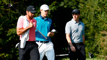 Leading lights: Rory McIlroy (right) with Jordan Spieth (centre) and Jason Day on the 16th at Firestone yesterday. Photo: Sam Greenwood/Getty Images