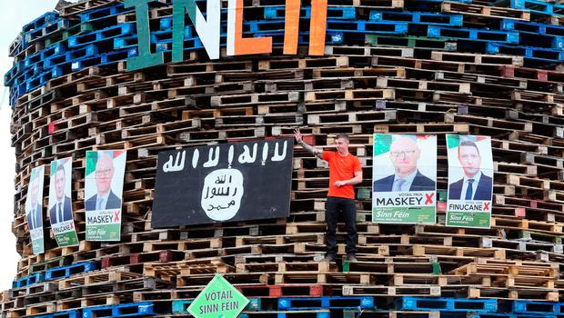 Posters of Sinn Fein politicians are seen placed on a bonfire in the Shankill area of west Belfast, Northern Ireland on July 10, 2017, ahead of the traditional 11th night bonfires [Photo: Paul Faith/AFP/Getty Images]