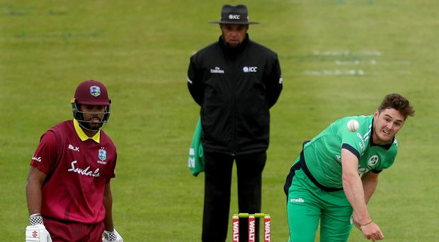 Ireland's Mark Adair (right) was left heartbroken after a dramatic finish against the West Indies.
