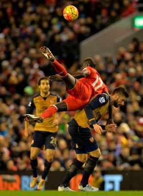 Arsenal's French striker Olivier Giroud (R) vies with Liverpool's French defender Mamadou Sakho during the English Premier League football match between Liverpool and Arsenal at Anfield stadium in Liverpool, north-west England on January 13, 2016. AFP PHOTO / PAUL ELLIS RESTRICTED TO EDITORIAL USE. NO USE WITH UNAUTHORIZED AUDIO, VIDEO, DATA, FIXTURE LISTS, CLUB/LEAGUE LOGOS OR 'LIVE' SERVICES. ONLINE IN-MATCH USE LIMITED TO 75 IMAGES, NO VIDEO EMULATION. NO USE IN BETTING, GAMES OR SINGLE CLUB/LEAGUE/PLAYER PUBLICATIONS.PAUL ELLIS/AFP/Getty Images