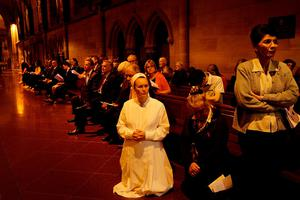 SYDNEY, AUSTRALIA - NOVEMBER 16:  Members of the Sydney Catholic and French community gather for mass at St Mary's Cathedral in honour of victims and those affected by recent terror attacks in Paris on November 16, 2015 in Sydney, Australia. 129 people died and hundreds were injured in Paris on Friday following a series of terror attacks in the French capital.  (Photo by Lisa Maree Williams/Getty Images)