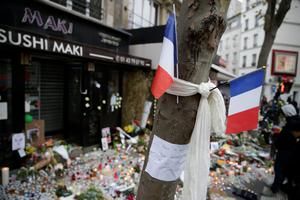 "French flags and a note reading ""We will not let you spoil our children's lives"" at the site of the attack at the Cafe Belle Equipe on rue de Charonne in the 11th district, early on November 16, 2015 in Paris, three days after the terrorist attacks that left over 130 dead and more than 350 injured. France prepared to fall silent at noon on November 16 to mourn victims of the Paris attacks after its warplanes pounded the Syrian stronghold of Islamic State, the jihadist group that has claimed responsibility for the slaughter.  AFP PHOTO / KENZO TRIBOUILLARDKENZO TRIBOUILLARD/AFP/Getty Images"