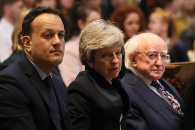 Taoiseach Leo Varadkar, Prime Minister Theresa May and President Michael D Higgins before the funeral service (Brian Lawless/PA)