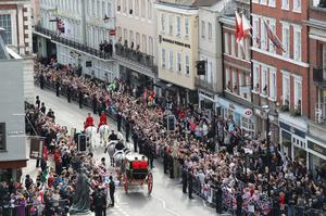 Crowds cheer Jack Brooksbank and Princess Eugenie as they embark on a carriage ride (Andrew Matthews/PA)
