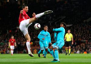 Manchester United's Zlatan Ibrahimovic (left) and Feyenoord's Miquel Nelom battle for the ball during the UEFA Europa League match at Old Trafford, Manchester. PA