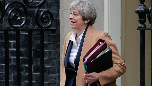 British Prime Minister Theresa May leaves 10 Downing Street before heading to the Houses of Parliament to attend the weekly Prime Minister's Questions. Pic: PA wire