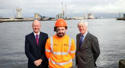 Joe O'Neill CEO Belfast Harbour, Gerry McQuade CEO BT Enterprise with Belfast Harbour Technician Marc McCombe with the live 5G enabled AR device