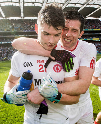 Big winners: Sean Cavanagh celebrates with Richard Donnelly