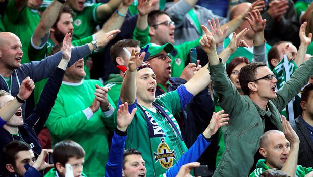 Northern Ireland fans celebrate after Northern Ireland won the UEFA Euro 2016 qualifying Group F football match between Northern Ireland and Greece at Windsor Park in Belfast, Northern Ireland, on October 8, 2015.    AFP PHOTO / PAUL FAITHPAUL FAITH/AFP/Getty Images
