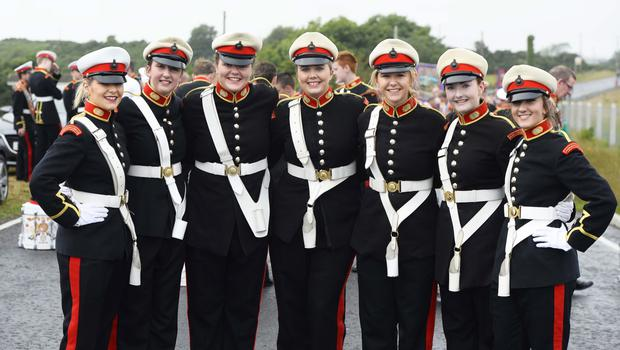 Pictured are Pride of Ballinran's Clare Glenny with Sarah McConnell,Sophie Annett,Megan Holmes,Laura Glenny and Lindsay Norris with Darcy Campbell. Ballymartin and Kilkeel 12th of July celebrations. Picture Mark Marlow