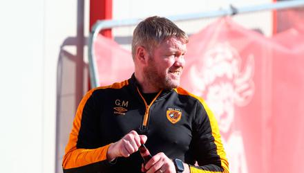 Grant McCann begins the celebrations after guiding Hull City to promotion.