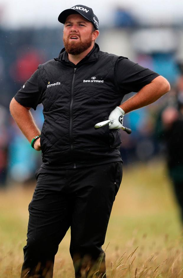 Shane Lowry in the rough on the 1st during day four of The Open Championship at Royal Portrush (David Davies/PA)