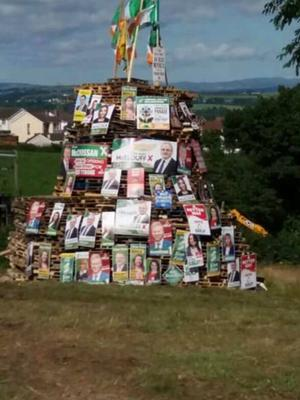 SDLP MLA Daniel McCrossan posted this photo of one of his election posters on a bonfire and said he considers the action a hate crime.