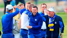 Up of the Cup: Rory McIlroy and his victorious team-mates begin their celebrations