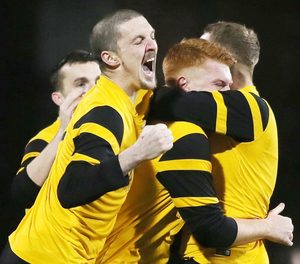 Crying wolff: Josh Cahoon (centre) is mobbed by his H&W Welders team mates after opening the scoring