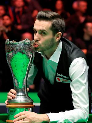 Sealed with a kiss: Mark Selby plants a smacker on the UK Championship title
