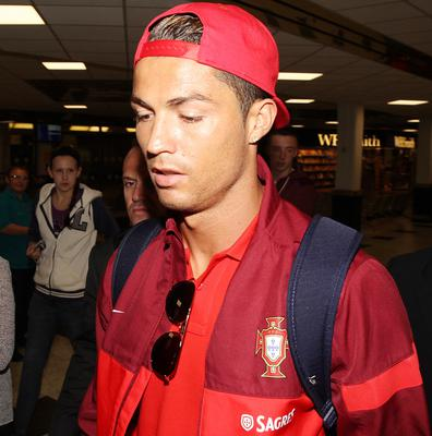 @Press Eye Ltd Northern Ireland-5th September   2013 Mandatory Credit - Brian Little/ Presseye  Portugal's Chistiano Ronaldo arrives with his team at Belfast International Airport ahead of Friday night's World Cup Qualifier against Northern Ireland at Windsor Park.